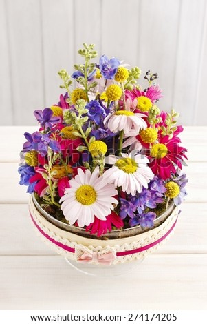 Table floral arrangement with gerbera flowers