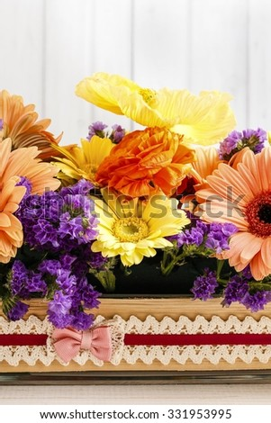 Table floral arrangement with gerbera flowers - stock photo