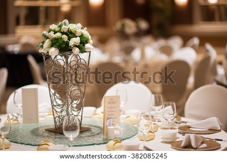 Table floral setup for grand wedding banquet - stock photo
