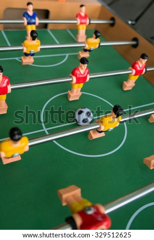 Table football game, Soccer table with red and yellow players