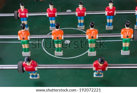 Table football game with red and orange players  - stock photo