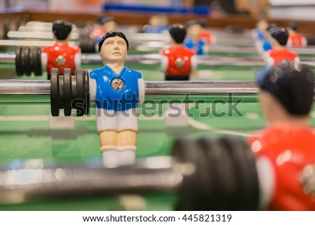 Table football or soccer, Red and Blue players from top down - stock photo