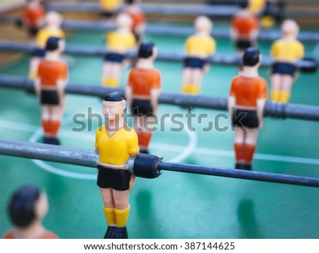 Table football Soccer game with Red and yellow players Team