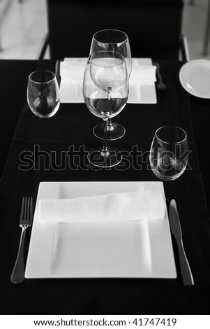 Table for business lunch with glasses and napkin. Focus on napkin