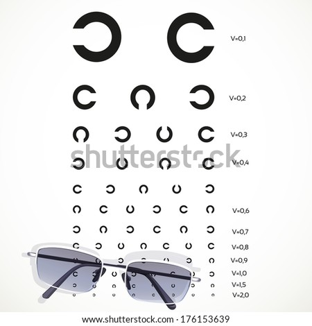 Table for eye tests with glasses on white background - stock photo