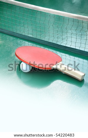 table for tenis with a racket - stock photo