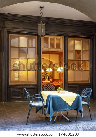 table for two at a restaurant in italy - stock photo