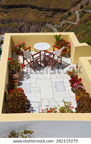 Table for two on the beautiful balcony over the sea, Greece, Santorini - stock photo