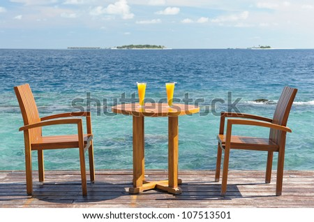 Table for two with cocktails near the sea