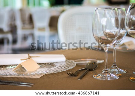 Table form a wedding with a label in the dish to put the name of the guests - stock photo
