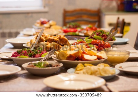 table full of homemade food - stock photo