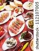 Table full of mediterranean appetizers, tapas or antipasto - stock photo