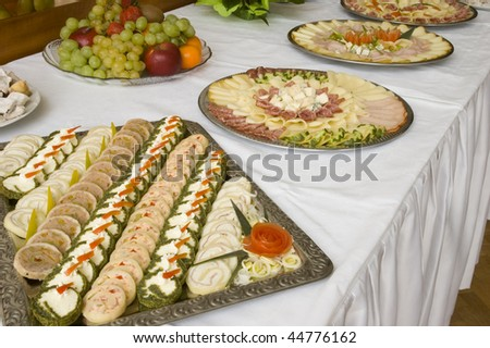 Table full of various tasty food. - stock photo