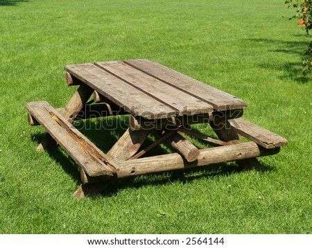 table in a park on green grass - stock photo