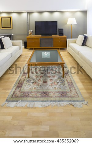 table in contemporary living room - stock photo