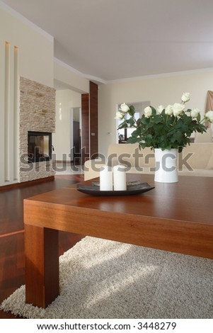 Table in modern living room - stock photo