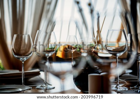 Table in restaurant served for lunch. Photo with beautiful bokeh. - stock photo