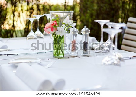 table in restaurant tableware glass banquet summer napkin silver white - stock photo