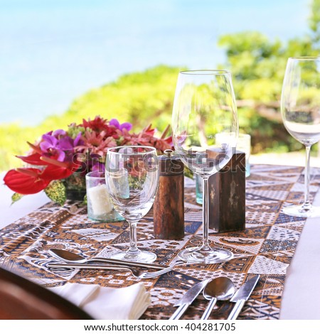 table in the restaurant on the sea background - stock photo