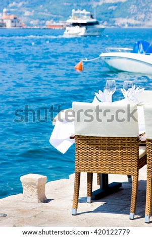table in the restaurant on the sea background, Perast