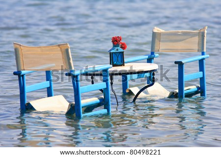 Table in the sea for romantic dinner