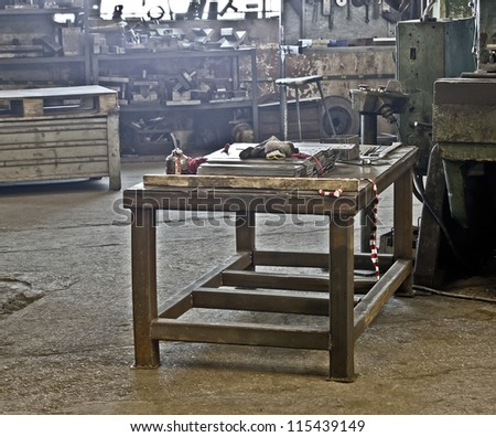 table in workroom - stock photo