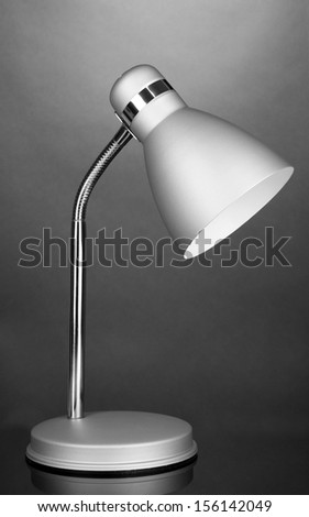 Table lamp on grey background - stock photo