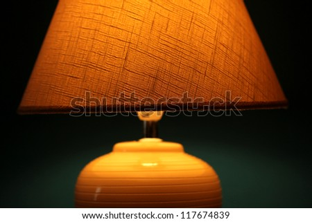 table lamp on wallpaper background