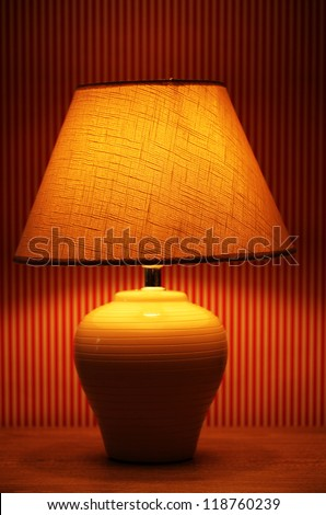 table lamp on wallpaper background - stock photo