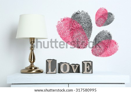 Table lamp with word Love and fingerprint heart - stock photo