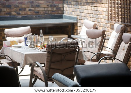 Table layout in the interior of the house for receiving guests at the party. Vertical photo - stock photo