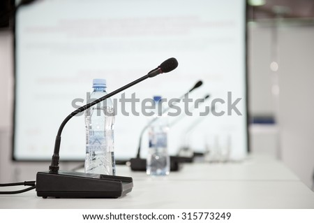 Table microphone at conference hall - stock photo