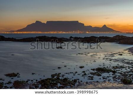 Table Mountain beach sunset - stock photo