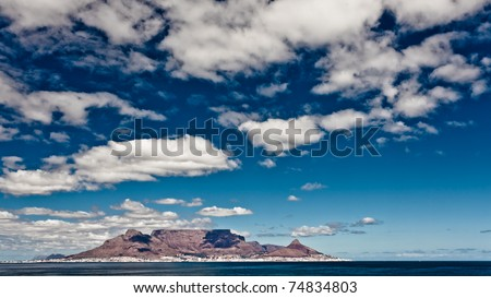 Table Mountain in Cape Town afternoon view from Blouberg. - stock photo