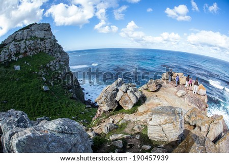 Table Mountain National Park, located on the Cape of Good Hope peninsula, is one of the most visited National Parks in Africa. The park contains a unique floral environment with thousands of species. - stock photo