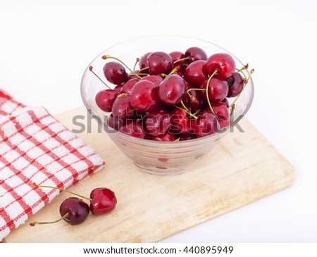 Table  of fresh red cherries, cherries in the bowl and cherries spilled from the basket - stock photo