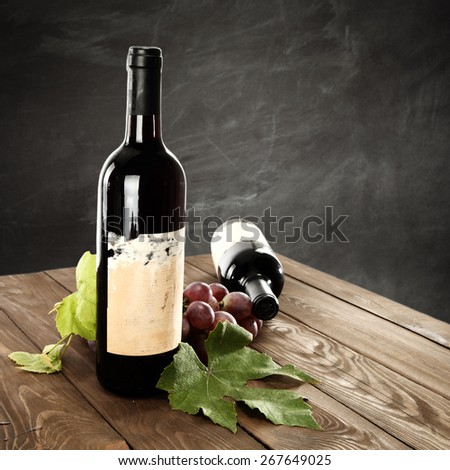 table of wine and grapes  - stock photo