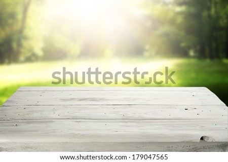 table of wood and sunset in garden  - stock photo