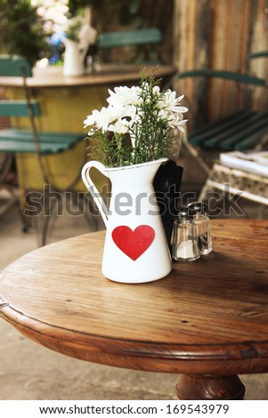 Table on cafe background - stock photo