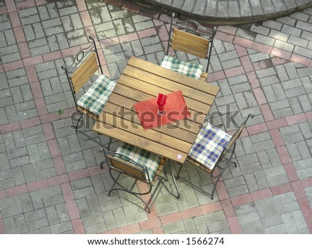 table on street cafe - stock photo