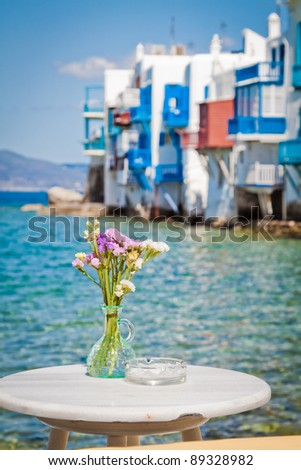Table on the sea in Little Venice, Mykonos, Greece. - stock photo