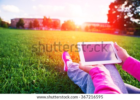 table pc in a hand for a girl - stock photo