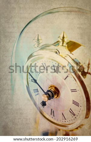 Table period clock with oscillating mechanism on grunge background  - stock photo