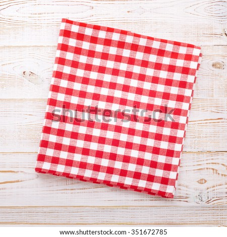 Table place setting. Food background. Tablecloth napkin on white wooden background