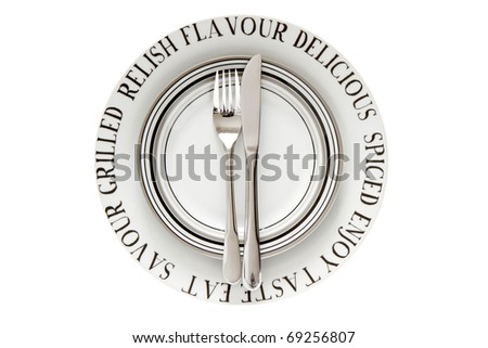 Table place setting with decorative plates isolated on a white background - stock photo