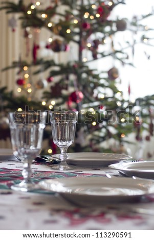 table prepared for christmas dinner to serve - stock photo