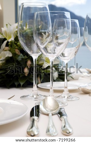Table preparing for after wedding ceremony diner in luxury hotel's restaurant.