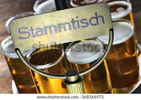 table reserved for regular guests in a German pub with served Koelsch (specialty beer from Cologne) (translation: cracker-barrel) - stock photo