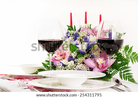 Table served with candles and wine - stock photo