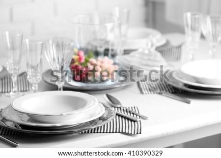 Table set at restaurant on light background - stock photo